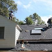 Workers repairing a roof from Action Roofing in Middlesex County, Massachusetts