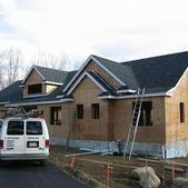 A new home with a completed roof finished by Action Roofing in Middlesex County, Massachusetts