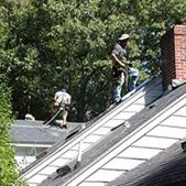 Roof maintenance being completed by Action Roofing in Middlesex County, Massachusetts